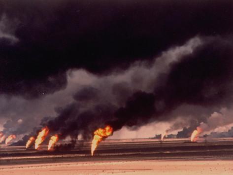 gary-kieffer-burning-oil-wells-shooting-flames-and-smoke-into-air-set-afire-during-gulf-war