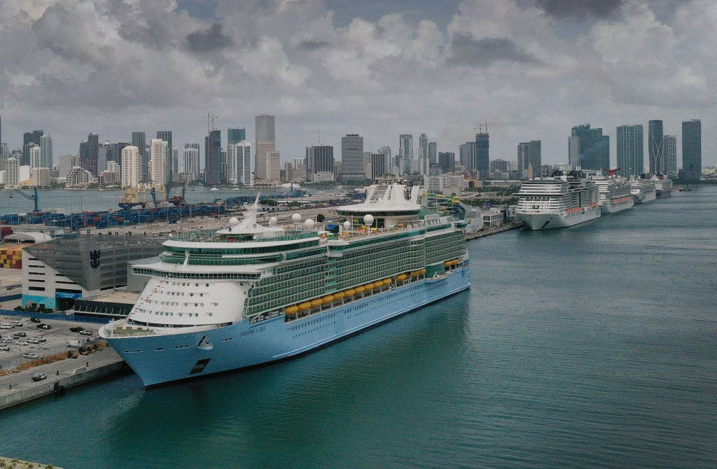 The Royal Caribbean's Freedom of the Seas departed Miami, the first time a cruise ship has sailed from a US port in 15 months.